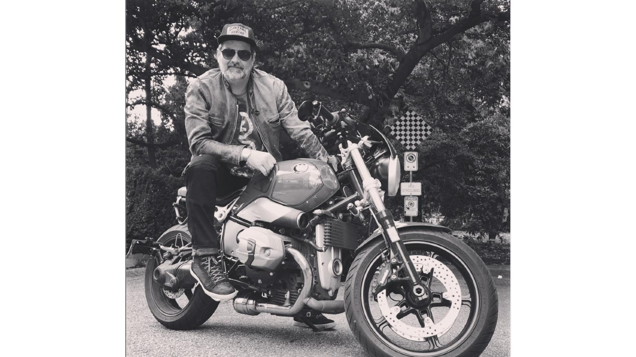 Black and white image of Art Green, founder of Road Astronaut, on his motorcycle.